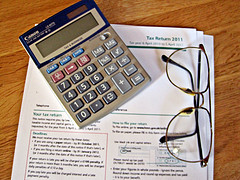 Taxes, Calculator and Glasses | Source: Images_of_Money